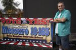 Tom McKirgan stands in front of his house with a campaign sign supporting the Douglas County Second Amendment Preservation Ordinance on Oct. 23, 2018 in Camas Valley, Oregon. McKirgan is a member of the Three Percenter militia and helped write the Douglas County ordinance.