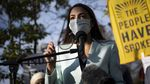 Rep. Alexandria Ocasio-Cortez, D-N.Y., speaks with other Democratic members of Congress outside of the Democratic National Headquarters in November, urging then-President-elect Biden to address the climate crisis.