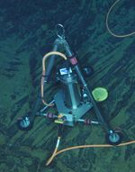 A bottom pressure/tilt instrument is used to measure change in the ocean floor around the Axial Seamount.
