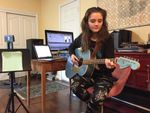 Josephine Relli plays guitar in the family basement, which serves as her classroom and music studio. She's a student at an online charter school, Oregon Connections Academy.