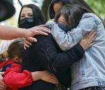 Kennedy Garrett, 24, center, is comforted by her sister, right, and family members after speaking about her father, Robert Delgado of Portland, who was killed by Portland Police in Lents Park earlier in the month.