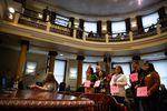 Proponents of the housing ordinance proposed by the Portland City Council hold up a sign in support during testimony on April 4, 2019.