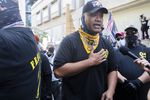 """Proud Boy Tusitala """"Tiny"""" Toese gives an interview  in front of the Justice Center during pro-Trump and pro-police demonstrations in downtown Portland on Aug. 22. Toese recently volunteered with the Clark County Republican Party."""