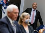 Marc Short, the chief of staff to the vice president, listens to Vice President Mike Pence speak during a White House event in September. Short is the latest aide to test positive for the coronavirus.