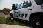 Flowers and messages adorn a Clark County Sheriff's Office SUV outside a memorial service for slain detective Jeremy Brown on Aug. 3, 2021. Brown died July 23 while investigating a trio suspected in a firearms heist, records show.