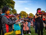 Violinists, violists and cellists of all ages came out to play improvised music at a vigil for Elijah McClain at Peninsula Park in Portland, Ore., Friday, July 3, 2020.