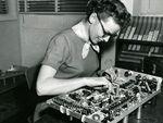 Woman assembling scope, ca 1950s