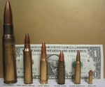 A .50-caliber round, as shown on the left, is the type of ammunition used in the machine gun in Emry's possession.