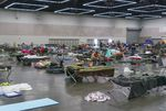 Hundreds have sought shelter at a cooling center at the Oregon Convention Center in Portland, June 28, 2021. The cooling center provided water, snacks, meals, blankets, and cots or mats for sleeping.
