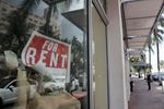 In this July 13, 2020 file photo, a For Rent sign hangs on a closed shop during the coronavirus pandemic in Miami Beach, Fla.  Having endured what was surely a record-shattering slump last quarter, the U.S. economy faces a dim outlook as a resurgent coronavirus intensifies doubts about the likelihood of any sustained recovery the rest of the year.