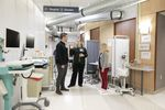 Left to right, Cory Woodyatt, R.N., Tonya Brockman, R.N., and Melinda Hartenstein, R.N., discuss protocols, March 24, 2020. The former OHSU auditorium space was converted to work as a routing area for people coming to the emergency department with respiratory symptoms that could be coronavirus-related. The area has intake, a waiting area that meets social distancing needs, triage and testing.