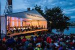 Members of the Oregon Symphony perform for a large crowd at the annual Waterfront Concert and Festival. After a four-year hiatus, the Symphony is bringing the festival back.