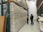 Researcher Chris Goldfinger joins curator Val Stanley in the chilled repository where geologic sediment cores are kept at Oregon State University in Corvallis.