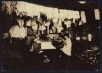 The Ceru family makes artificial leaves in a tenement attic in New York City in January 1912. Modern urban planning was a product of overcrowding in tenement housing projects.