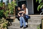 Marissa Williams and her son, Mason, sit on their porch.