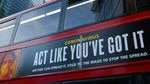 """Moderna will test new COVID-19 vaccine boosters, saying that while its vaccine should protect against variants found in the U.K. and South Africa, it isn't as effective against one strain.  Here, a bus in London carries a sign telling people, """"Act Like You've Got It"""" — to prevent the coronavirus from spreading."""