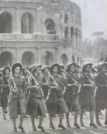 Young women in military-style uniforms with guns, members of the Giovane Italiane (Young Italians) fascist youth group, pictured marching in Rome, circa 1935
