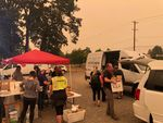 Volunteers served meals at the state fairgrounds in Salem, where an evacuation center was established for people fleeing the Santiam Fire.