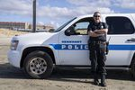 Gearhart Police Chief Jeff Bowman stands for a portrait next to his patrol car on the beach in on February 9, 2021 in Gearhart, Oregon.