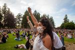 "Attendees of the vigil for George Floyd raise their fists during a Black Riders Liberation Party led chant of ""Power to the People"" in Peninsula Park in Portland, Ore., Friday, May 29, 2020."