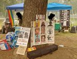 A Black Lives Matter flag and posters memorializing Black Americans killed by police in recent years are displayed at Hawthorne Park in September 2020. The park was swept by police on Sept. 22, resulting in 11 arrests.