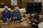 Washington Gov. Jay Inslee and his wife, Trudi, wear masks in the governor's office before making a statewide televised address on COVID-19, which health officials have warned is accelerating rapidly throughout the state, Thursday, Nov. 12, 2020, at the Capitol in Olympia, Wash.