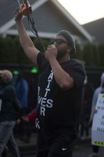 Isiah Wagoner shouts into the bullhorn at a protest march against police brutality in Eugene, Ore.