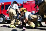 Instructors for the bootcamp led drills that emphasized teamwork, such as learning how to properly load hoses.