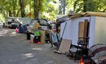 In this photo from July 26, tents, trailers and cars line SW Oak St. next to Portland's Laurelhurst Park.