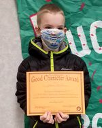 """Josh Frank holds an award for """"being a champion helper and the greatest improvement in showing good character in school"""" at Birch Elementary in Nampa, Idaho in 2021. An Oregon judge ruled that Frank was denied a year of a school by the Hood River County School District, a decision that reinforces the guarantee that students with disabilities should have access to a free and appropriate public education."""