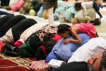 Women pray at the Muslim Educational Trust in Tigard, Oregon, during Ramadan. Fear is not a new feeling for many in communities of color in Portland, but the knife attack on a MAX train has amplified it — especially for Oregon Muslim communities.