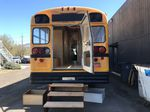 A school bus being converted into temporary housing.