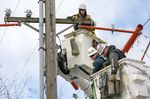 PGE contractors from DJ's Electrical in Portland repair a transformer box on a power pole on Southeast Madison Street near 17th Avenue in Portland, Feb. 16, 2021. Portland General Electric officials said post of its customers' power will be restored by Friday night.