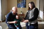 Whitney and Brittany Young play with their son Hazen. Using 'preimplantation genetic diagnosis' they made sure he doesn't carry the family's BRCA gene mutation and its increased risk for cancer.