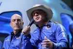 Mark Bezos, left, listens as his brother Jeff Bezos, founder of Amazon and space tourism company Blue Origin, describes the experience after their launch from the spaceport near Van Horn, Texas, Tuesday, July 20, 2021.