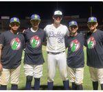 Mark Triolo, center, with members of the junior Venados baseball club in Mazatlán, Mexico.