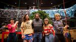 """Stage hands raise the Christmas tree during a """"Batman Returns Returns"""" rehearsal at Revolution Hall. Producers Neil Fridd (center left), Zack Traeger (center), and writer/director Megan Tabaque (center right)."""