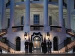 L-R: President Joe Biden, first lady Jill Biden, Vice President Kamala Harris and Doug Emhoff, hold a moment of silence and candelight ceremony in honor of those who lost their lives to the coronavirus outside the White House on Monday evening.