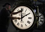 Dan LaMoore adjusts the hands on a Seth Thomas Post Clock at Electric Time Company, Friday, Oct. 23, 2020, in Medfield, Mass. Daylight saving time ends at 2 a.m. local time Sunday, Nov. 1, 2020, when clocks are set back one hour.