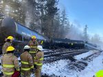 Emergency crews respond to the scene of a derailed train in the city of Custer, Washington, in Whatcom County on Tuesday, December 22, 2020. A BNSF spokesperson said seven train cars derailed and two caught fire.