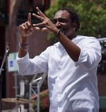 Rian Gayle interprets the music of a deaf hip-hop artist at the Make Music event in Salem in June 2019.