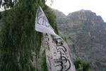 The Taliban flag hangs on the Afghanistan-Pakistan border in front of the mountains of Khyber Pakhtunkhwa province.