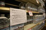 A Roth's Fresh Markets grocery store in Salem asks customers to limit water purchases to two cases of 16.9-ounce bottles or 4 gallons of water per family.