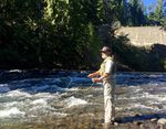 Jeff Thomas fishes for bull trout at the base of Clear Creek Dam. He's hoping to catch the fish to help move them around the dam.