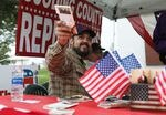 Eric Parker hands out copies of the U.S. Constitution as he campaigns at the Gooding Pro Rodeo in Gooding, Idaho on Sept. 18.
