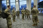 National Guard members wait for training before the start of the vaccination clinic being held at the Oregon Convention Center, Jan. 27, 2021.