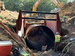 Crews in Bellingham replace an old culvert (center) with a new 12-foot diameter pipe. The old culvert was too smalland sat too high for juvenile fish to navigate during their migration to their spawning grounds.