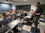 The CDC announced Thursday that fully vaccinated people can safely stop wearing masks indoors. Kyle Faircloth, Associate Professor of Intercultural Studies, is seen teaching a class at Palm Beach Atlantic University in West Palm Beach, Fla., in February.