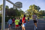 A group of current and former Madras High School students plays basketball at Sahalee Park in Madras, Ore., on Sept. 1, 2020.