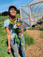 Mirabai Collins, co-founder and co-director of the Black Futures Farm in Southeast Portland, holds a bouquet of fresh flowers.